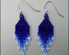 Title: Sweet Earth  Description: These earrings are beaded in brick stitch in turquoise green glass seed beads. Silver lined orange bugle beads
