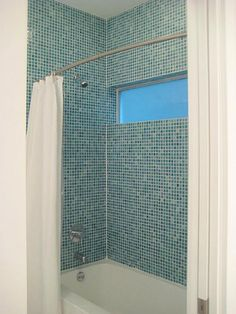 Beautiful Italian Blue Teal Colored Tiles Surround The Downstairs Shower Tub,  Above Windows Bring In The Natural Light!