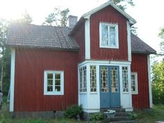 little house in Sweden with a blue door