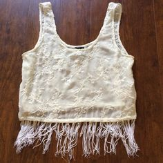 White Chiffon Fringe Crop Top White chiffon material with beautiful embroidery all over. Fringe bottom, only worn once, but fringe unravels a little can be fixed by trimming when necessary.  ❌no trades ❌no PayPal ❌no holds ✅reasonable offers ✅ bundle discounts Forever 21 Tops Crop Tops
