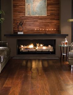 BR-111 Exotic Hardwood Flooring. Wow, that fireplace! and the wall treatment....love it!