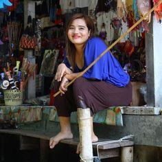 """Floating Market vendor, Bangkok Thailand with her """"boat catcher stick"""" :)"""