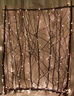 lighted twig screen easy to make? yourhandcraftedgarden.com/lighted_twig_screens__garden_gates