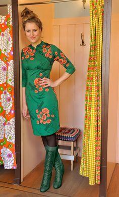 Model wears the Mandarin dress Quincy.