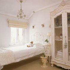 Antiques, including a charming chandelier, add history and create an enchanting aesthetic.