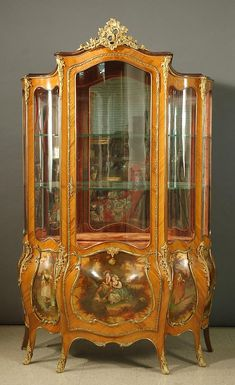 """LOUIS XV STYLE ORMOLU-MOUNTED AND 'VERNIS MARTIN' VITRINE, French, early 20th century, of  serpentine form, the interior with two glass and one red velvet covered wood shelves of  conforming shape, and further featuring five hand painted pictorial panels across the base. Dimensions; 77""""H x 47.5""""W."""