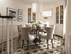 Great dining room chairs with a black brown round tulip dining table