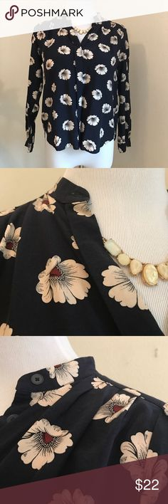 """Ann Taylor Floral Blouse Ann Taylor Floral Blouse , navy Blouse with hidden buttons, cream and burgundy flowers. Buttoned cuffs, soft Pleated styling. 100% rayon. Slight hi-lo hem. Shoulder to hem is 21"""", to back hem 23"""". Pit to pit approx 18"""" Ann Taylor Tops Blouses"""