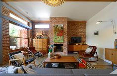 Nice furniture pieces... MCM chairs, low danish style buffets, and tall wooden file drawers maybe? midcentury living room by Jeni Lee