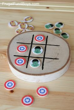 DIY Avengers Tic Tac Toe - The playing pieces are wooden discs.  This is too cool!  With a bag to store it in, it would be a great travel game!
