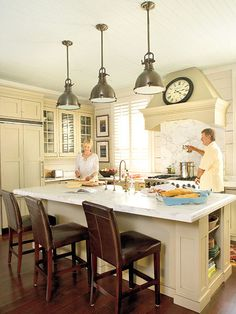 off-white cabinets, marble counters, nautical light fixtures