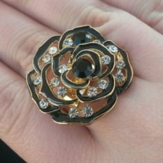 Black & Gold Rose Ring w/ Diamond Accents! This ring is adjustable 'one size fits all' It is black and gold and has little diamond gems scattered throughout the ring. Beautiful piece to add to you collection and a great accent piece for you outfit! Jewelry Rings
