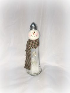 Eiffel tower glass salt shaker has been used to create his body. Faux snow and glitter added to his tummy. He has vintage buttons attached t… Dollar Tree Christmas, Christmas Crafts For Gifts, Christmas Diy, Diy Snowman, Snowmen, Snowman Wreath, Halloween Ornaments, Christmas Ornaments, Christmas Decorations