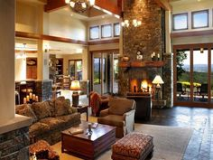 stone fireplace in traditional open plan living room