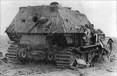 """The slow moving Porsche Tiger (P) """"Ferdinand"""" was easily overrun due to it's slow mobility as seen here on this abandoned and knocked out example during the fighting at Kursk during 1943"""