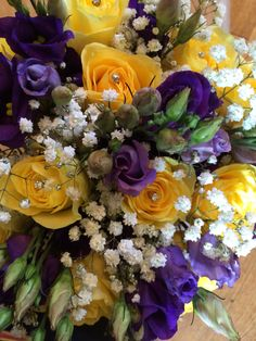 Brides Yellow and purple wedding flowers with gypsophila roses and Lizzy hand tied natural style loose country style