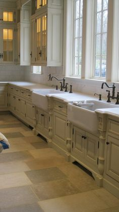 Gorgeous Kitchen. Love the cabinet color & farmhouse sinks & the travertine flooring with the varied colors of neutrals in each travertine tile that complement the cabinets so perfectly!
