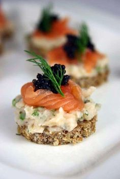 "July is National Caviar Day! Real-deal caviar comes from sturgeon, but salmon roe is a good budget-friendly substitute. Try this recipe ""Cannelini bean, salmon & caviar canapés"" Canapes Salmon, Salmon Caviar, Yummy Food, Tasty, Appetisers, Finger Foods, Appetizer Recipes, Appetizer Ideas, Easy Meals"