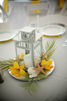 #yellow lily #beach centerpiece/ Orlandoweddingflowers/ www.weddingsbycarlyanes.com