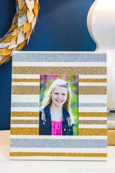 For an almost-instant desktop pick-me-up, cover a plain Jane frame with strips of glittery craft tape.