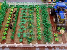 LEGO garden idea - great use of greenery to make so many different plants. Love the tractor, too