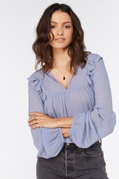 The Sara Frill detail blouse is a flowly number that is perfect for work and play. With volume in the sleeves and body, you can tuck it in or wear it loose. Material: 100% Viscose No Frills, Work Wear, Ruffle Blouse, Number, Play, Detail, Sleeves, How To Wear, Tops