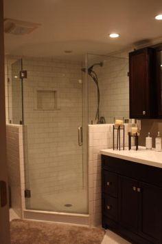 corner shower, darker cabinets