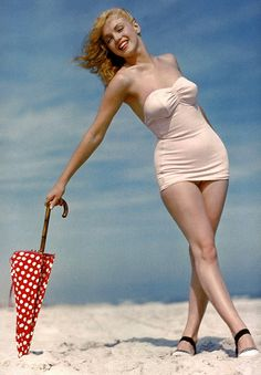 .marilyn. Beautiful.  Can't believe she would be considered over weight for model in today's expectations. Sad.    (Love the bathing suit style too)  <3