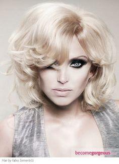 Medium length blond hairstyle.