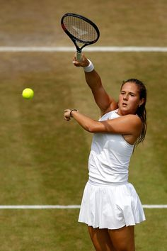 Daria Kasatkina of Russia plays a forehand smash against Alison Van Uytvanck of Belgium during their Ladies' Singles fourth round match on day seven of the Wimbledon Lawn Tennis Championships at All England Lawn Tennis and Croquet Club on July 9, 2018 in London, England.