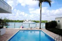 Poolside across from beach - Tequesta style