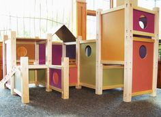 modular wooden dollhouse/playhouse - you can change the configuration - i thought it was full sized but it isn't. wouldn't that be incredible if it was/