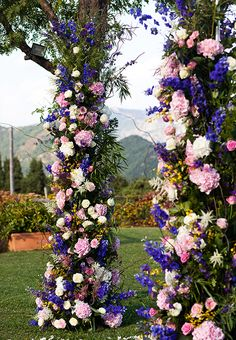 A lush ceremony floral arch | Brides.com