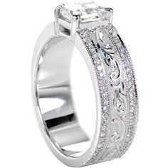 This stunning design features a very wide band with a 1.00 carat radiant cut center diamond. There is a row of micro pavé accenting each edge of the band with a row of hand engraved patterns in the middle. #engagement #wedding #ring #jewelry www.knoxjewelers.biz