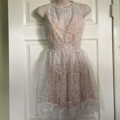 NWT Charlotte Russe lace dress Never worn and white and nude/cream color dress Charlotte Russe Dresses Midi