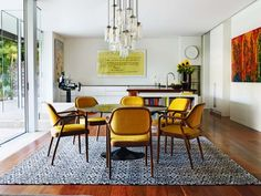 19 dining spaces you would be proud to have in your home: The dining space of Argentinean architect Diego Balagna's Sydney home features yellow and timber 1960s Knoll dining chairs by Eero Saarinen's assistant Don Petitt.  Photo: Prue Ruscoe
