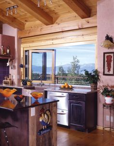 Now THAT is a #kitchen with a view. (Yes, those are #purple cabinets.)