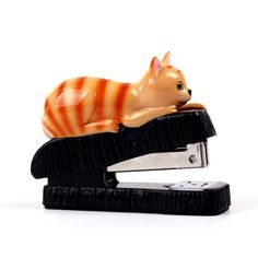 Animate your space with animals. This imaginative stapler features an administrative-minded tabby cat ready to pounce on unruly sheafs of contracts, essays, and more. Pushing papers will be much more playful with this helpful critter.