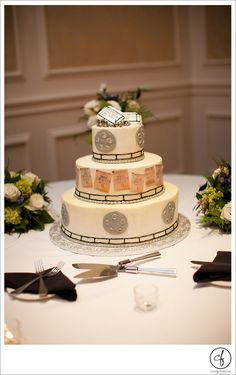 Movie themed wedding cake by Edibles Incredible   (Currie FitzHugh Photography)