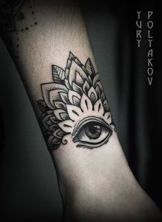 Yury Polyakov eye tattoo