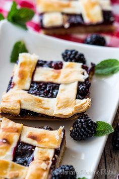 These super easy Blackberry Pie Bars are a real treat with a buttery shortbread crust, a berry packed  fruit filling and a secretly easy lattice crust.