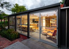 Cox Architecture adds steel and glass conservatory to 1920s house in Canberra.