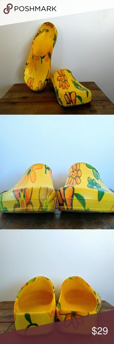 Preloved Birkenstock Floral Garden Clogs Super cute, roomy clogs from Birkenstock. Made from waterproof, floral plastic, making them perfect for the garden or the beach. High quality, made in Germany. Good preloved condition. The bottoms are quite dirty and there are a few dirt stains inside, but the outside of the shoes are clean and there is no real wear on the the soles. Marked euro size 40 and US mens size 8, so they fit a US women's 10 nicely. Birkenstock Shoes Mules & Clogs
