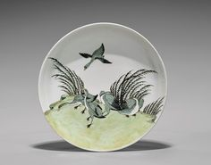 """YONGZHENG PERIOD PORCELAIN DISH: Geese. Beautifully enameled in pure Chinese taste, early 18th Century Yongzheng Period, porcelain dish; with exquisitely enameled design of geese amid grasses to the front and to underside; D: 10"""""""