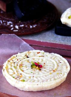 Sandesh (Bengali: সন্দেশ Shôndesh; Hindi: संदेश) is an Indian dessert created with milk and sugar. Some recipes of Sandesh call for the use of chhena (Indian cheese) or paneer instead of milk. Some people in the region of Dhaka call it Pranahara (literally, heart 'stealer') which is a softer kind of sandesh, made with mawa and the essence of curd.