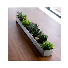 The simple and solid design of the Rectangular Planter Box makes it extremely versatile. It can, of course, be used to store fruit, but it also looks great filled with plants or candles.