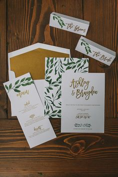 Pair modern calligraphy with green and gold for a modern woodland wedding invitation