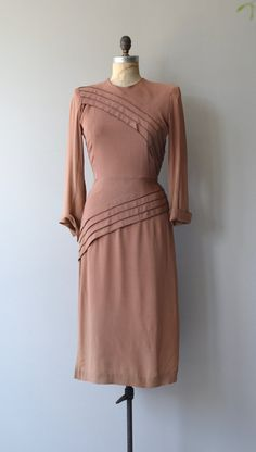 A head turner, no doubt. Vintage 1930s dark dusty blush rayon dress with flat ruffles on bodice and skirt trimmed in tiny sparkling copper beads. long