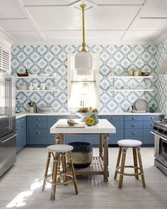 In this Harbour Island kitchen, there are no upper cabinets, which allow the patterned kitchen walls to carry the day. Painting Kitchen Cabinets, Kitchen Paint, New Kitchen, Kitchen Decor, Kitchen Ideas, Kitchen Inspiration, Kitchen Walls, Decorating Kitchen, Island Kitchen