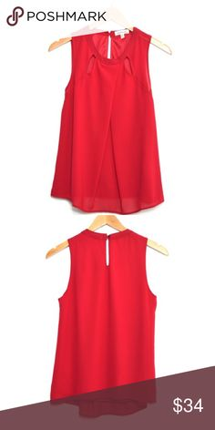 Red Top With Keyhole Back So adorable! Perfect color for the holidays! True to size with a relaxed fit. Has a lining underneath. Tops